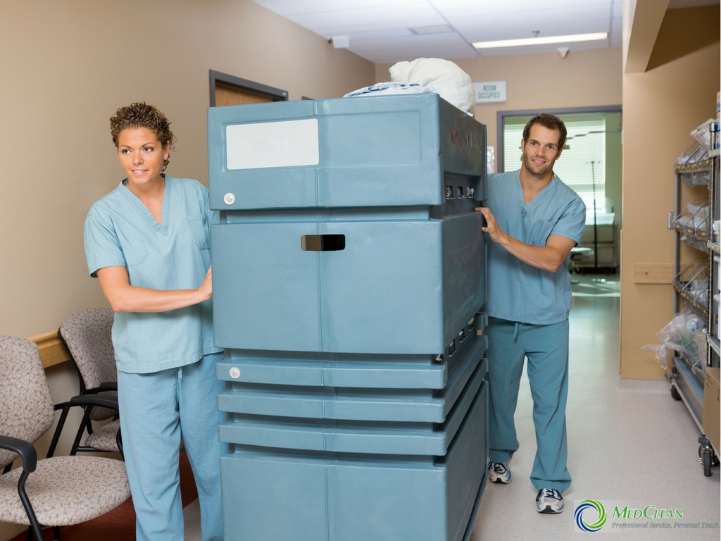healthcare professionals with medical linen cart